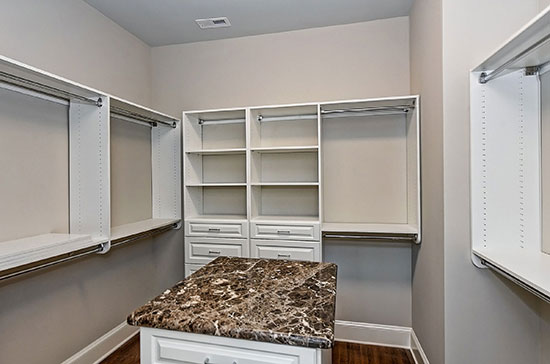 closet with island in it