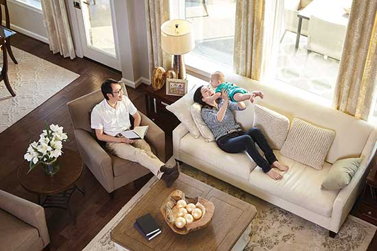 man and woman lounging in living room with infant