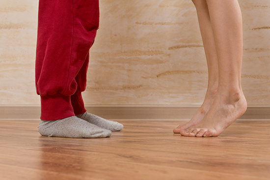 Dancing in socks on a hardwood floor
