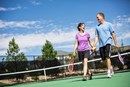Couple Playing Tennis on Tennis Courts at Pathfinder Park